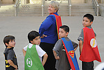 Wearing their super-hero capes ,Mayor Annise Parker strikes a pose with, from left, Harper Wallace, Jack Wallace, Damian Lara and Fabian Lara on the steps of City Hall Monday April 13, 2015.This followed  Mayor Parker's reading of a proclamation of April as Child Abuse Prevention Month.(Dave Rossman photo)