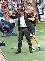 Barclays Premier League, Swansea City (white) V West Ham United, 05/08/12, Liberty Stadium Swansea. <br /> Pictured: Swans manager Michael Laudrup celebrating his team's win after the final whistle.<br /> Picture by: Ben Wyeth / Athena Pictures<br /> Athena Picture Agency<br /> info@athena-pictures.com