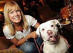"""Kelly Fitzpatrick with Roxy at the """"Dog Days of Summer"""" Yappy Hour benefitting Citizens for Animal Protection and Golden Beginnings Golden Retriever Rescue at Hotel Derek Wednesday July 21,2010.(Dave Rossman/For the Chronicle)"""