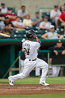 San Antonio Missions shortstop Jeudy Valdez (24) follows through on his swing in the Texas League baseball game against the Frisco Roughriders on August 22, 2013 at the Nelson Wolff Stadium in San Antonio, Texas. Frisco defeated San Antonio 2-1. (Andrew Woolley/Four Seam Images)