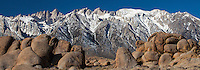Snow covered Mt Whitney in Sierra Mountains from rock formation at Alabama Hills, California