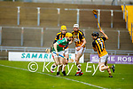 Crotta's Declan O'Donoghue tries to get past Abbeydorney's Jack Parker, Stephen Egan and James O'Connor in their round 2 game of the County Senior hurling championship