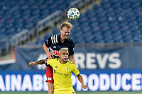 FOXBOROUGH, MA - OCTOBER 3: Henry Kessler #4 of New England Revolution and Randall Leal #8 of Nashville SC battle for head ball during a game between Nashville SC and New England Revolution at Gillette Stadium on October 3, 2020 in Foxborough, Massachusetts.