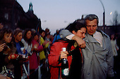 West Berlin, West Germany<br /> November 10, 1989<br /> <br /> A man crossing from East Berlin to West Berlin hugs a woman while celebrating the opening of the Berlin Wall. Germans gathered at the wall after the East German government lifted travel and emigration restrictions to the West the day before.