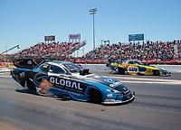 Apr 14, 2019; Baytown, TX, USA; NHRA funny car driver Shawn Langdon (near) races alongside Ron Capps during the Springnationals at Houston Raceway Park. Mandatory Credit: Mark J. Rebilas-USA TODAY Sports