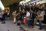 Stockport Lancashire teens busking in shopping center in Mersey Square known as the Bear Pit.  1980s England.