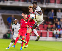WASHINGTON, DC - OCTOBER 11: Erick Rizo #3 of Cuba pushes the ball away from Josh Sargent #19 of the United States during a game between Cuba and USMNT at Audi Field on October 11, 2019 in Washington, DC.