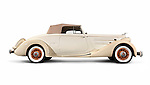 1935 Packard Twelve Coupe Roadster by Dietrich ivory beige classic vintage luxury car isolated on white background with clipping path Image © MaximImages, License at https://www.maximimages.com