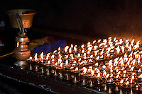 Bodhnath, Nepal.  Candles Burning at a Buddhist Shrine.