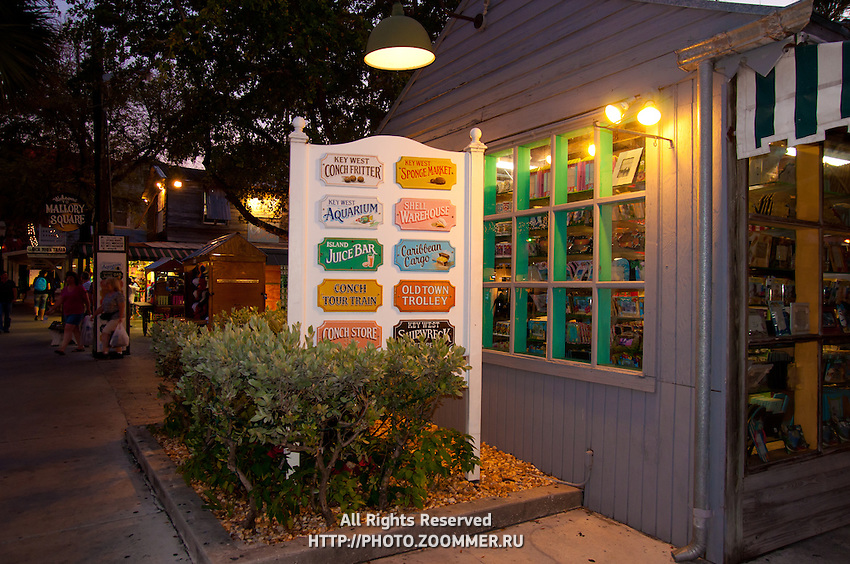 Old shops and signs of Key West in the evening.