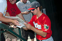 Fort Wayne TinCaps pitchr Walker Weickel (33) signs autographs before a game against the Great Lakes Loons on August 18, 2013 at Dow Diamond in Midland, Michigan.  Fort Wayne defeated Great Lakes 4-3.  (Mike Janes/Four Seam Images)