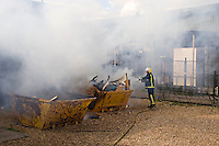 Firefighters using a Hose Reel extinguish a Skip Fire Warwickshire UK. This image may only be used to portray the subject in a positive manner..©shoutpictures.com..john@shoutpictures.com