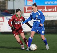 20160116 - ZULTE , BELGIUM : Zulte-Waregem's Liesa Capiau (L) and Gent's Emma Van Britsom (R)  pictured during a soccer match between the women teams of ZULTE-WAREGEM and AA GENT B  , during the fifteenth matchday in the First League - Eerste Nationale season, Saturday 16 January 2016 . PHOTO DIRK VUYLSTEKE