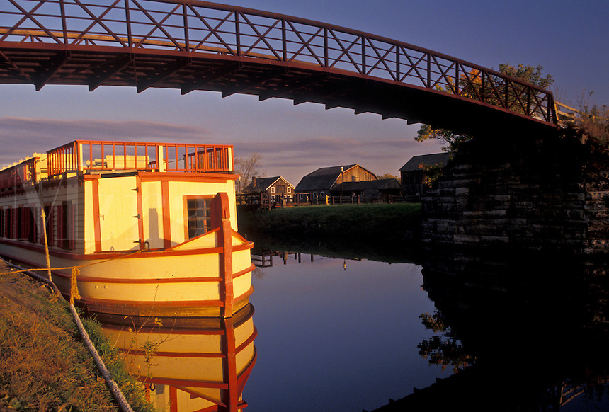 AJ3102, Erie Canal, barge, reflection, New York, A barge reflects in the calm water of the Erie Canal at the Erie Canal Village in Rome in the state of New York.