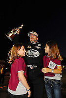 Nov. 13, 2011; Pomona, CA, USA; NHRA top fuel dragster driver Del Worsham celebrates with his daughters after winning the Auto Club Finals at Auto Club Raceway at Pomona. Mandatory Credit: Mark J. Rebilas-.