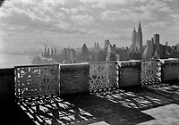 View from the parapet on the 27th floor of the River House at 52nd St. and E. River, New York City. December 1931.<br /> <br /> Photo by Gottscho-Schleisner