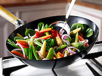 Stirfry cooking being cooked in a wok