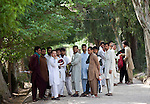 2 June 2013,  Jalalabad, Afghanistan.  Students line he paths on campus at Nangarhar University in Jalalabad.  Many of the facilities and equipment at the University are being provided under the World Bank funded Strengthening Higher Education Program (SHEP). The objective of the program is to restore basic operational performance at a group of core universities in Afghanistan. It aims to act as a catalyst to attract resources at Afghan tertiary education in the long term.  SHEP is the first major education investment in Afghanistan by the World Bank. In 2008 it received $US 5 million from ARTF to expand infrastructure and equipment to Universities in Kabul, Nangarhar , Balkh and Kandahar.  Picture by Graham Crouch/World Bank