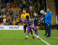 22nd September 2021; Molineux Stadium, Wolverhampton,  West Midlands, England; EFL Cup football, Wolverhampton Wanderers versus Tottenham Hotspur; Japhet Tanganga of Tottenham Hotspurs and Rayan Ait Nouri of Wolverhampton Wanderers come together near the side line as they challenge for the ball