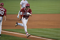 Arkansas infielder Matt Goodheart (10) runs home for a score, Saturday, June 5, 2021 during the first inning in the second game of the NCAA Fayetteville Regional at Baum-Walker Stadium in Fayetteville. Check out nwaonline.com/210606Daily/ for today's photo gallery. <br /> (NWA Democrat-Gazette/Charlie Kaijo)