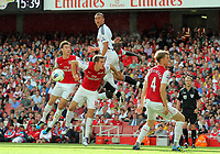 Pictured: Steven Caulker of Swansea (TOP) heads the ball over L-R Aaron Ramsey, Laurent Koscielny and Bacary Sagna of Arsenal. Saturday 10 September 2011<br />