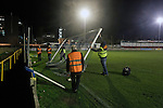 Runcorn Town 1 Runcorn Linnets 0, 26/12/2013. The Pavilions, North West Counties League Premier Division. Groundstaff dismantling the goals after the Boxing Day derby match between Runcorn Town and visitors Runcorn Linnets at the Pavilions, Runcorn, in a top-of the table North West Counties League premier division match. Runcorn Linnets won 1-0 and overtook their neighbours at the top of the league in a game watched by 803 spectators. Runcorn Linnets were a successor club to Runcorn FC, one of England foremost non-League clubs of the 1970s and 1980s. Photo by Colin McPherson.