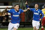 Fraser Aird scores the opener and celebrates