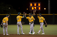 Teammates of the AZL Athletics celebrate after an Arizona League game against the AZL Giants Black at the San Francisco Giants Training Complex on June 19, 2018 in Scottsdale, Arizona. AZL Athletics defeated AZL Giants Black 8-3. (Zachary Lucy/Four Seam Images)