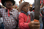 San Salvador Atenco peasants hold up machetes as they protest against the destruction of an ecosystem in a ravine of Cuernavaca city in the southern state of Morelos, April 10, 2006. Enviromentalists and members of The Other Campaign, along with the Delegado Zero, the Zapatista leader Subcommander Marcos, joined to the struggle and defend the ecosystem, where the state government tries to construct an avenue. Photo by Heriberto Rodriguez