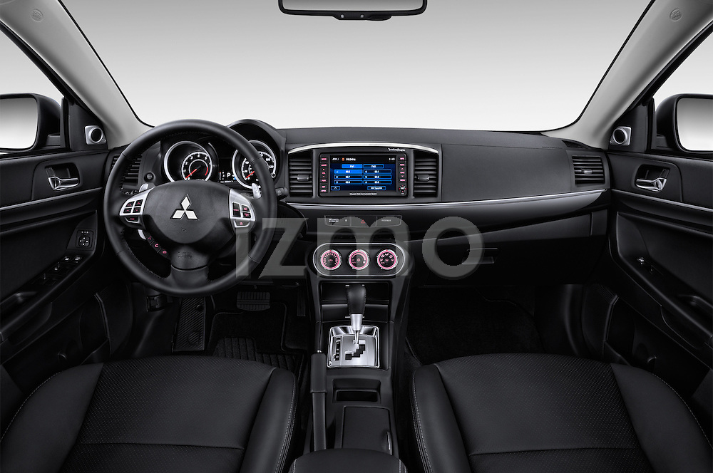 Stock photo of straight dashboard view of a 2015 Mitsubishi Lancer  Sportback 5 Door Hatchback