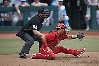 North Carolina State Wolfpack catcher Luca Tresh (24) frames a pitch as home plate umpire Adam Dowdy looks on during the game against the North Carolina Tar Heels at Boshamer Stadium on March 27, 2021 in Chapel Hill, North Carolina. (Brian Westerholt/Four Seam Images)