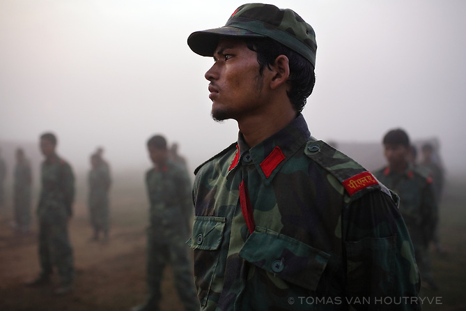A Maoist rebel soldier of the People's Liberation Army stands in formation for early morning physical training at cantonment in Nawalparasi, Nepal on 29 October 2007. The PLA have been in UN monitored camps since a peace deal between the Maoists and Nepal's other political parties was agreed to in the Spring of 2006