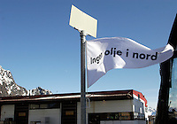 Small flag with protest against proposed oil drilling off the Lofoten coast. Cod fishing is a traditional practice in Lofoten, home to around 24,500 people and and an area where locals have been producing Stockfish for over 1000 years. Lofoten is where the World's largest and last cod stocks are found, in the Barent's Sea. Fishing is as strong an industry as tourism in this region.