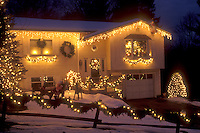 AJ5863, house, home, Christmas, decorations, lights, snow, winter, A house is elegantly trimmed with tiny white lights for the Christmas holiday season in Montpelier at night in Washington County in the state of Vermont.