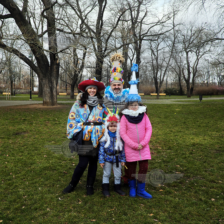 From the left: Jana, Petr, Anicka and Anton, from the town of Slany, dressed in costumes for the Masopust carnival.