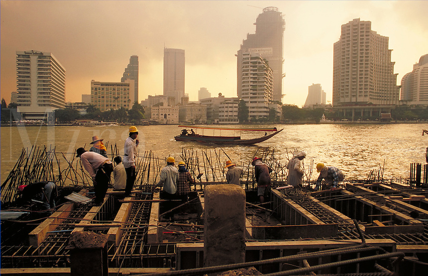 The Peninsula. The last of the mid 90's construction boom in Bangkok, Thailand. Overview of laborers working with rebar. Bangkok, Thailand.