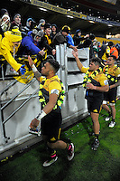 Willis Halaholo (left), Chris Eves and Vaea Fifita thank fans after the Super Rugby final match between the Hurricanes and Lions at Westpac Stadium, Wellington, New Zealand on Saturday, 6 August 2016. Photo: Dave Lintott / lintottphoto.co.nz