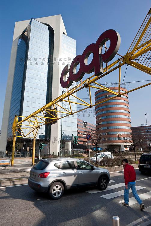 """Sesto San Giovanni (Milano), palazzi per uffici e l'insegna del supermercato coop --- Sesto San Giovanni (Milan), office buildings and the sign of """"coop"""" supermarket"""