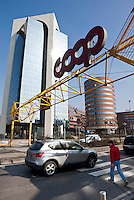 "Sesto San Giovanni (Milano), palazzi per uffici e l'insegna del supermercato coop --- Sesto San Giovanni (Milan), office buildings and the sign of ""coop"" supermarket"