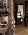 A maid steps out the Elizabethan kitchen at Canons Ashby. (M.R.)