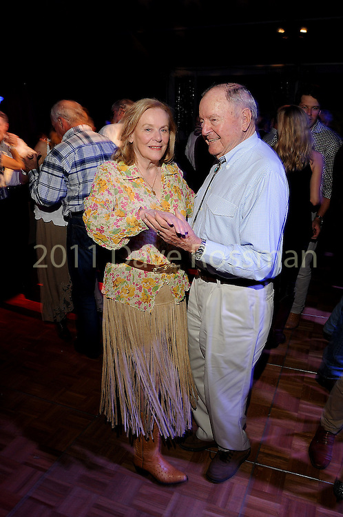 Honorees Anne and Charles Duncan dance at the Nature Conservancy's Nature Rocks  Gala at the Houston Polo Club Thursday Oct. 22,2015.(Dave Rossman photo)