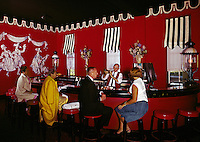 Well dressed adults at the bar of the Congress Hall Hotel in the 1960's.