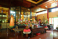 The beautiful and serene golden interior of the Kwan Yin Buddhist Temple in Honolulu.