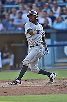 Charleston RiverDogs third baseman Miguel Andujar #5 swings at a pitch during a game against the Asheville Tourists at McCormick Field July 26, 2014 in Asheville, North Carolina. The RiverDogs defeated the Tourists 8-7. (Tony Farlow/Four Seam Images)