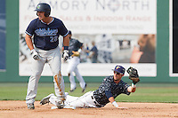 Everett Aquasox second baseman Jordan Cowan (3) makes a diving catch to force out Josh Anderson (28) of the Hillsboro Hops at second base during a game at Everett Memorial Stadium in Everett, Washington on July 5, 2015.  Hillsboro defeated Everett 11-4. (Ronnie Allen/Four Seam Images)
