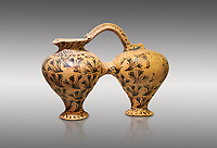 Minoan decorated double ewer with crocus flower  design,  Poros Heraklion 1800-1650 BC;  Heraklion Archaeological  Museum, grey background.