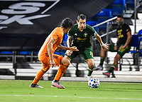 LAKE BUENA VISTA, FL - JULY 18: Diego Valeri #8 of the Portland Timbers is defended by Zarek Valentin #4 of the Houston Dynamo during a game between Houston Dynamo and Portland Timbers at ESPN Wide World of Sports on July 18, 2020 in Lake Buena Vista, Florida.