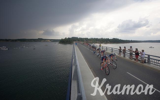 peloton over the bridge of the Lac de Pareloup<br /> <br /> stage 14: Rodez - Mende (178km)<br /> 2015 Tour de France