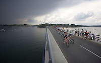 peloton over the bridge of the Lac de Pareloup<br /> <br /> stage 14: Rodez - Mende (178km)<br /> 2015 Tour de France