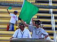 Grand-Am flagger Tani Miller gets a helping hand from a young admirer at the Sahlen's Six Hours at the Glen, Watkins Glen International Raceway, Watkins Glen, NY, June 2010.  (Photo by Brian Cleary/www.bcpix.com)